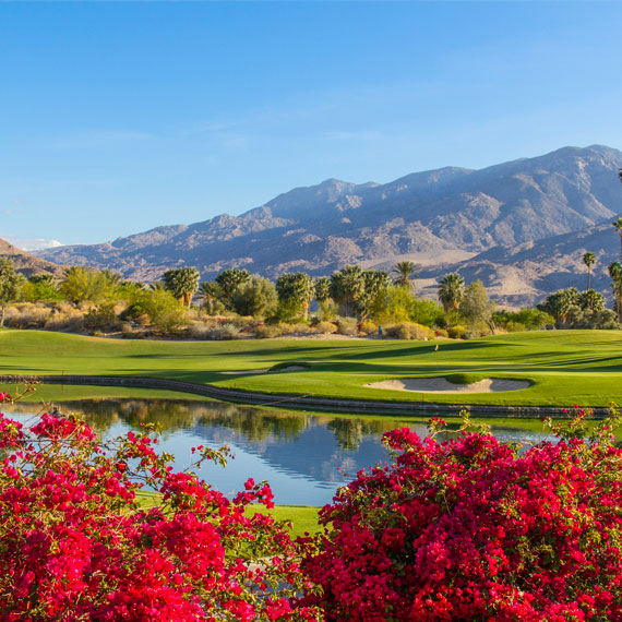 golf course with mountains in the background in california