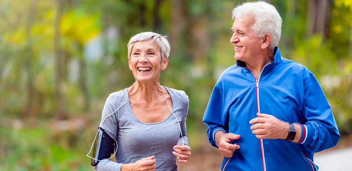 Two senior adults exercising